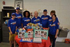 Volunteers Wearing Progressive Insurance T-Shirts