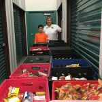 Young man delivers collected items to K.I.S.S.